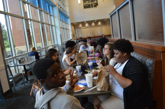 At the 2015 Teen Appeal camp, student staffers eat lunch in the University of Memphis' University Center.