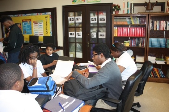 Middle College High School freshmen and seniors train in a recent debate practice. By Eboni Johnson