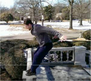 onathan McCarver lands with precision at a parkour session in Overton Park. Photo provided by Desmond Catron.