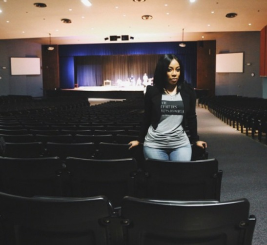 K. Michelle poses proudly in the school theater at Overton High School. Photo by Khari Bowman.