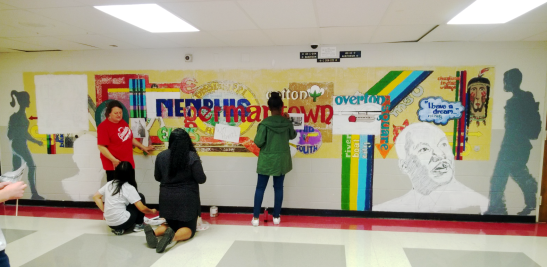 Student artists at Germantown High School are given the chance to work on the school's mural, replacing the existing one.  Photo by Hira Qureshi.
