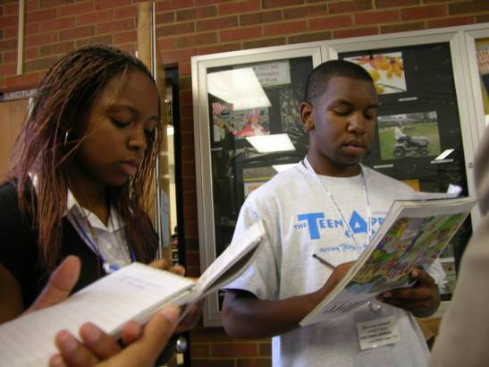 Two Middle College High School students take notes during the 2007 Teen Appeal camp at the University of Memphis. Folasade Omogun (left) received a B.A. in English and History from Clark Atlanta University and is currently a law student at the University of Tennessee in Knoxville, scheduled to graduate in 2016. She has studied abroad at Edge Hill University in London and the University of West Indies in Kingston, Jamaica. Branden Asemah (right) graduated from Bowdoin College in Maine with a B.A. in Gender and Women's Studies/Africana Studies with a minor in Education Studies. He now works as an Associate Producer for Bloomberg Television in New York and previously studied abroad in New Delhi, India.
